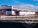 Immagine di Quota di 1/8 di Capannone artigianale con annesso corpo di fabbrica ad uso uffici ed abitazione custode oltre ad area scoperta pertinenziale.